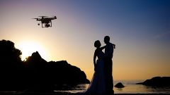 Drone capturing wedding photographs