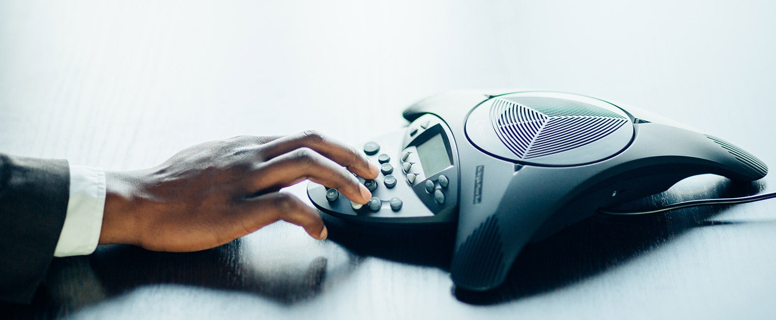 businessman operating voip phone