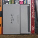 Kindle Oasis on bookshelf