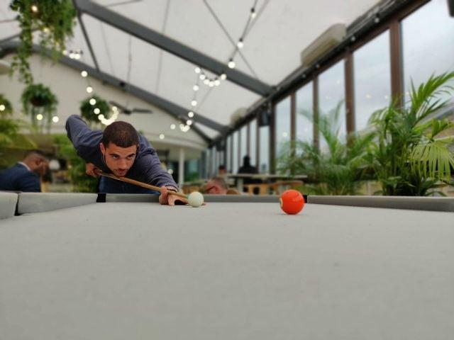 Man playing pool with Bokeh effect taken on OnePlus 7