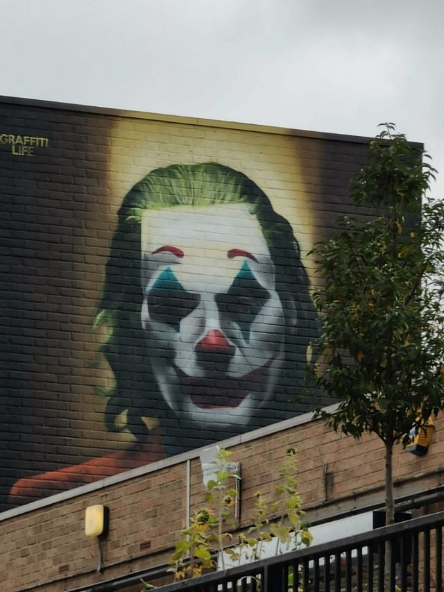 high zoom on mural of clown face