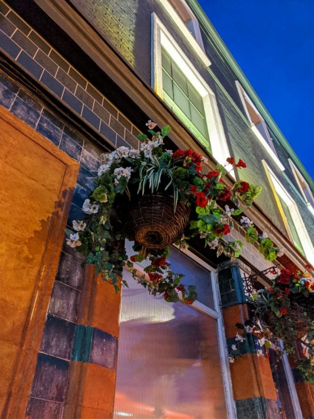 hanging flower basket outside pub taken on google pixel 4 xl with night mode
