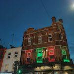 photo of london pub lit up at night