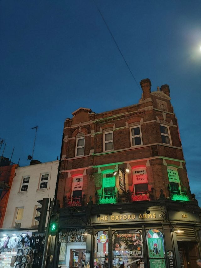photo of london pub lit up at night