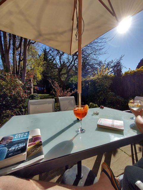aperol spritz sitting on table on a sunny day