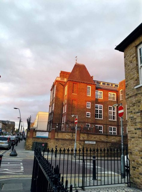 london school building bathed in sunset